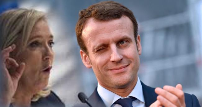 Marine Le Pen ir Emanuelis Makronas