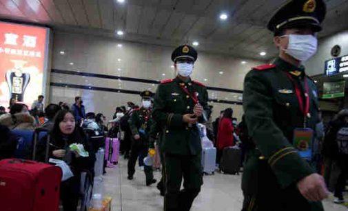 Kinijoje jau 13 miestų uždaryti karantinui