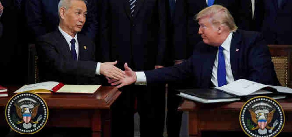 JAV susitaikė su Kinija ir pasirašė prekybos susitarimą