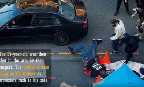 Sietle protestuojančių minia užpuolė pravažiuojantį vairuotoją – pastarasis ėmė šaudyti
